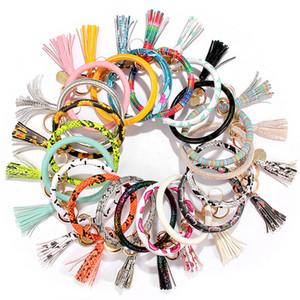 Neue 21 Styles von Creative-PU-Leder-Armband Schlüsselanhänger Rund Stück Anhänger Damen Lederarmband T3I5885
