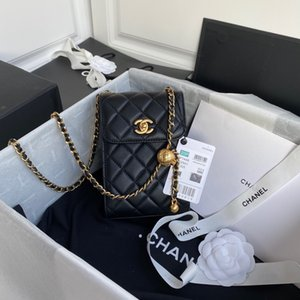 La borsa del corpo del telefono cellulare della nuova borsa delle donne è davvero in giro per il mondo è difficile trovare accessori in metallo dorato con lunghe cinghie