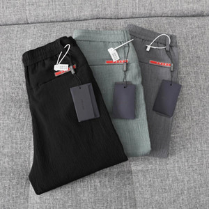 2020 summer bark wrinkle men's Korean leisure trend small feet trousers comfortable and refreshing not easy to wrinkle couple pantss