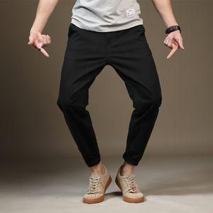 Glatter Ganzkörper nimmt Geschäfts-Hosen 2020 Designer Marke Cotton Straight Leg Stretch Männer Kleid Hose beiläufige kurze Hose dünne