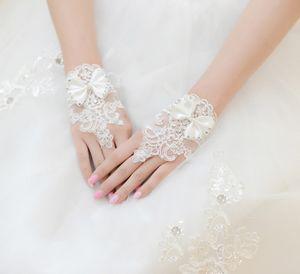 Mode-White Ivory Short Hochzeit Handschuhe Kristalle Perlen Knoten Handgelenk Länge fingerlose Spitze Brauthandschuhe