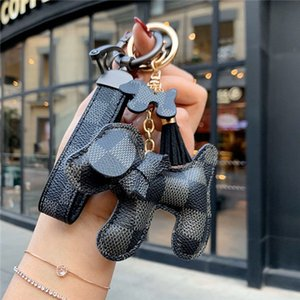 Manual high-grade braided rope brand key chain men and women leather car key chain ring leather rope bag stainless steel pendant