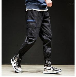 Calças Primavera Outono de carga com bolsos Mens Casual solta Drawstring Pants desenhador de moda dos homens Calças Lápis