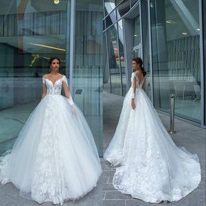 Bohème robes de mariée 2020 abordable dentelle Appliqued perles Sheer cou Robe de mariée balayage train manches longues Robes de mariée