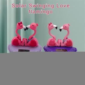 Accessori auto solare Scuotere la testa bambola solare Swinging Amore Flamingo decorazione dell'automobile della bambola del fumetto Interni bambini regalo Giocattoli