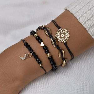 Vintage scava modo del braccialetto insieme di quattro delicata gioielli partito del braccialetto nero alla moda di Crescent / shell donne