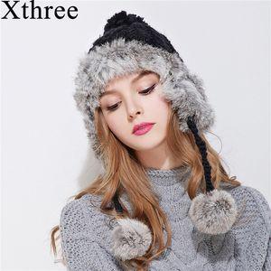 Xthree kulak flep kış bombacı şapka kadınlar için tavşan kürk örgü şapka kız sıcak katı renk kap rahat kaput D19011503 caps