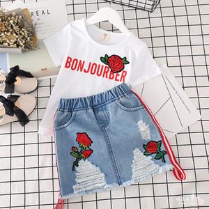مجموعة ملابس الأطفال تصميم جديد التطريز روز زهرة الاطفال قصيرة الأعلى + الدينيم تنورة 2 قطع مجموعة 2019 الصيف أزياء بوتيك ملابس الأطفال مجموعات
