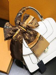 El nuevo diseño de la cinta de seda principal de doble capa impresa bufandas de seda de la marca de moda pañuelo cinta bolso de las mujeres pequeña bufanda larga 7 * 120cm
