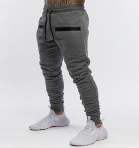 New fitness pants fashion men's casual pants muscle stretch slim feet running training pants Europe and the United States sports models