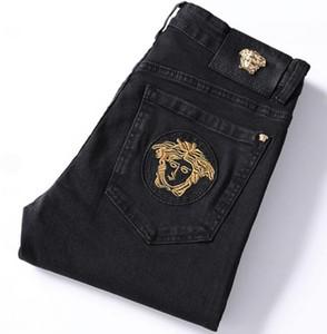 Мужчины бизнес ткани облегающие брюки джинсы мода бренд зима молодежь Прохладный Супер толстый красивый крутой мотоцикл Stretch вышитые мужские брюки