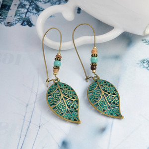 Hot Fashion Jewelry Vintage Hollow Out Leaf Bead Dangle Earrings Women's Earrings S228
