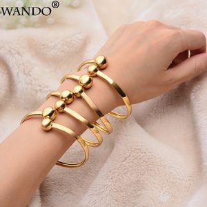 Braccialetti di WANDO 4pcs / lot della festa nuziale della Doubai di colore dell'oro per il commercio all'ingrosso etiopico africano dei gioielli del braccialetto della decorazione delle donne