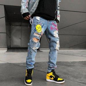 2019 Men Skinny Smiling Face Jeans Slim Fit Stretchy Blue Hole Jeans Cotton Lightweight Comfy Hip Hop Graffiti Denim pants w25