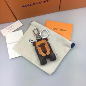Caja original equipaje de lujo llavero diseñador billetera colgante bolso león diseño muñeca coche cadena moda llavero entrega gratis