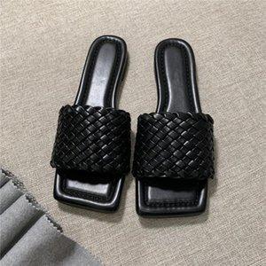 Principios de la primavera de punto zapatillas y sandalias de la manera comprueban la delgada superficie de tejido de piel de oveja con zapatillas suela de cuero damas