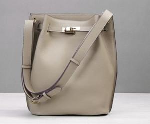 A nova primeira camada de couro bolsa de lazer ombro balde vertical bolsa de couro original em ferradura bolsa de ombro único das mulheres