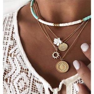 ALYXUY Retro Frauen Halsketten-Blumen-runde blaue Perle Geometric Anhänger Kette Mehrschichtige Goldhalskette Persönlichkeit Hochzeit Schmuck