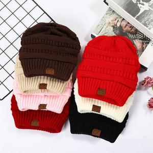 États-Unis d'automne et d'hiver de vente CC Mme Étiquetage Pure Color Chapeaux d'hiver Laine bordage Bonnet