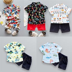 Bambini fumetto che coprono le ragazze dei ragazzi della maglietta Tops + Shorts vestito carino T Shirt 2 Pezzo attrezzature di estate dei bambini copre gli insiemi 25 colori