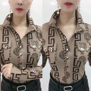 Europeo de primavera / estación de verano camisa de 2020 nuevos de la solapa de impresión de manga larga, diseño de la gasa de la blusa de la manera. Una figura delgada puede ir con cualquier cosa