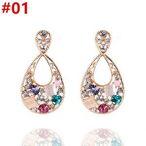 Neue Ohrringe Ohrringe weibliche europäische und amerikanische Retro-Champagne-Farben-Edelstein-elegante einfache lange Tropfen-Ohrringe