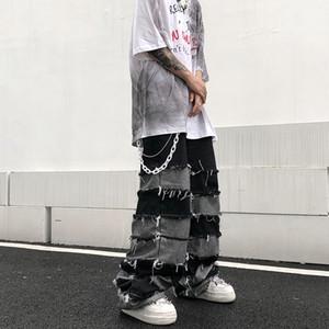 UNCLEDONJM Quaste Hosen Herrenmode Ins Anhänger Wide Leg Hip Hop Faul Wind Jeans Paar Hosen lose Jeans Männer