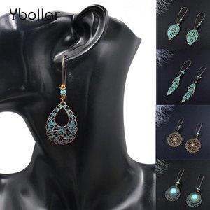 Étnicos de la vendimia cuelgan los pendientes de gota para las mujeres femeninas Hollow hoja redonda Waterdrop estrella Bohemia joyería