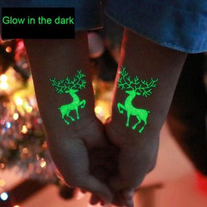 Glow in the Dark Christmas Tattoo Snowman Santa Reindeer Snowflake Disposable tattoos Party christmas decorations Drop Ship