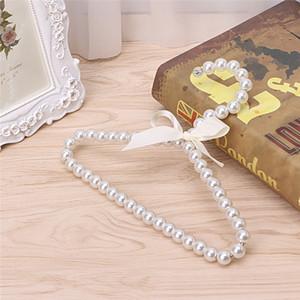 Commercio all'ingrosso 10 PCS Fashion Plastic Pearl Beaded Bow Baby Appendiabiti Storage Dry Rack Spedizione gratuita