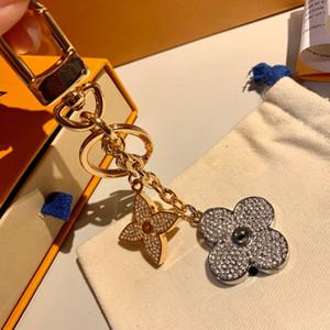Top Designer Schlüsselanhänger Luxus-Monogramm-Logos blühende Blumen Strass Schlüsselanhänger M64265 Legierung Kreis Auto-Schlüsselring-Taschen-Charme Keychain Kristall