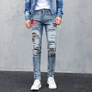 The new men's fashion ripped printed jeans are suitable for slim men's trendy jeans riding a motorcycle on their own