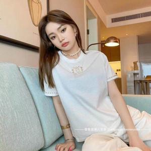 신제품 : 여름 2020 간단한과 여성을위한 가죽 디자인 라운드 넥 느슨한 짧은 소매 T 셔츠 체인 버튼 다목적