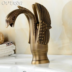 OUYASHI Luxury Bathroom Basin Faucets low Swan Faucets Deck mounted water tap