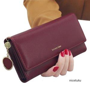 Ladies' long-sleeved fashion tassel zipper trend heart-shaped pendant lychee multi-functional student wallet