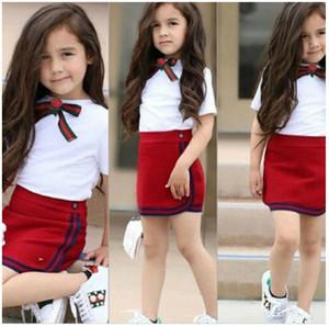 새로운 도착 여름 여자 교복 의류 활 꽃 타이 T 셔츠 +를 짧은 미니 스커트 2 개 세트 어린이 의상 소녀 정장 1-5년 탑 설정