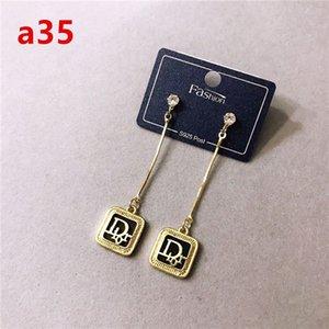 Fashion stainless steel copper four-leaf clover pendant earrings for women luxury designer