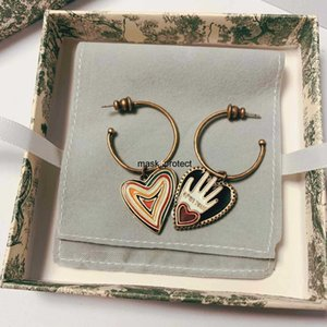 D home asymmetric earrings heart palm fashion design heart-shaped mesh red pop-up ear nails brass and silver pins
