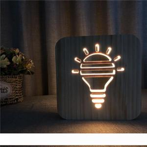 Forma de bombilla creativa Lámpara de mesa hueca de madera LED Luz de noche Cálido blanco Sólido Talla 3D Noche Lámpara