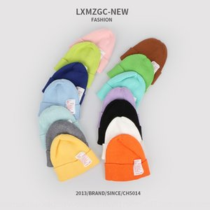 Children's new candy color warm windproof fashionable Warm knitted knitted hat cloth label men's and women's baby curled wool hat