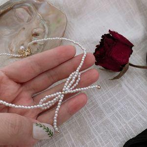 Fairy Bowknot Small Pearl Necklace Clavicle Chain Female Simple Temperament Neck Retro