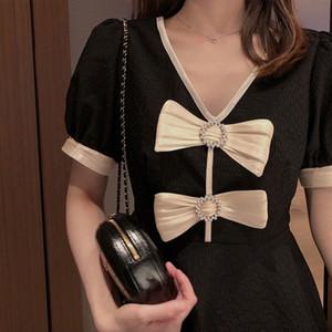 2020 French waist small black Hepburn Wind bow V-neck bubble sleeve Women's Small fashionable dress Butterfly dress