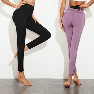 Female lift buttock exercise fitness show thin tight height waist pocket small feet nine minute pants