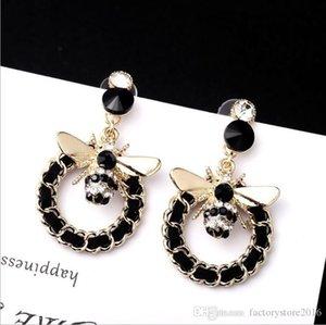 Pendientes de diseño de lujo con pendientes lindo Círculo Negro Piedra aleación de oro de abeja para joyería regalo de las mujeres