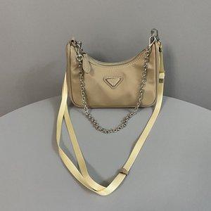 nouveaux sacs de torsion selle de dame design avec ceinture et chian véritable sac en cuir véritable moto épaule sacs crossbody de haute qualité