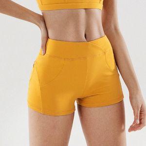 Йога Шорты Женщины Бег Фитнес Брюки Marathon Спортивные шорты Женские Йога Брюки Quick Dry Pants Бич Gym Workout Sexy Girl EEWI #