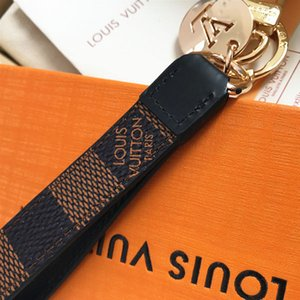 2020 Luxury keychain designer unisex key chain real leather with stainless steel keychain keyring in Golden with brown with box