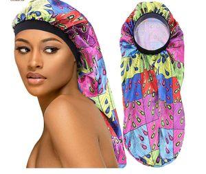 드리다 높은 품질 여성 아프리카 꽃에 대한 새로운 모방 새틴 보닛 수면 캡 긴 보닛 실키 헤어 느슨한 모자 도매 C342 인쇄