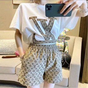 Set of fashionable casual women summer loose and slim short sleeve T-shirt + wide leg shorts two-piece fashion set
