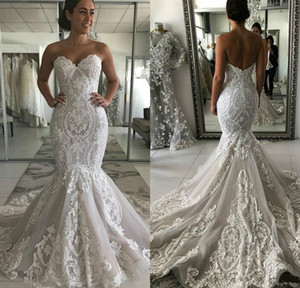 Sweetheart Mermaid Wedding Dresses 2021 Modern Backless Lace Applique Sweep Train Bohemian Fishtail Beach Bride Reception Gowns